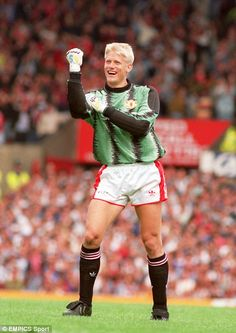 Manchester United goalkeeper Peter Schmeichel celebrates against Notts County in 1991