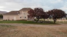 Charming 3500 sqft  Victorian on 5.25 acre Horse Property.  4 Bedrooms, 3 full baths, 1 1/2 Bath, Craft room, partially finished basement Open Floor Plan, jetted tub,  two car garage, central air, 36 x 36 barn w. 3 stalls and tack room, 1.5 acres fenced pasture/ riding arena, 2.5 acres planted in grass alfalfa mix, produces about 200 bales per year, 10.5 shares Strawberry High-line irrigation water,pressurized irrigation system for hay field  fully landscaped with underground sprinklers.