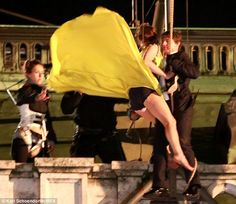 Revealing: Rebecca's dress got caught in a gust of wind as professional stunt woman Lucy Cork stood nearby to assist