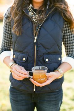 Love this dressed up/down outfit. Quilted vest over houndstooth sweater (thank you for the correction Maddie Snidarich), adorned with oversized necklace and chunky watch. Fall amazingness! Via J'Adore J. Crew