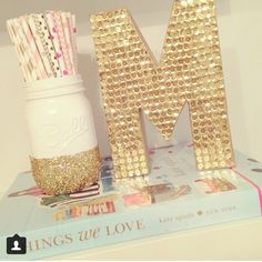 Glue sequins to a painted wooden letter