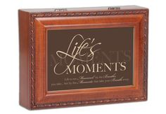 "Life's Moments Cottage Garden Woodgrain Traditional Music Box Plays Edelweiss by Cottage Garden. $29.99. Approximately 8.5"" x 6.5"" x 3"". Makes A Perfect Gift Or Family Keepsake.. Timeless Woodgrain Finish. Plays Edelweiss. Easily Personalize With Your Own Photos And Messages. This beautifully trimmed Music Box / Jewelry Box makes the perfect gift. The Sankyo brand musical movement is enclosed in glass for an added touch of luxury. Use the photo opening to add you..."