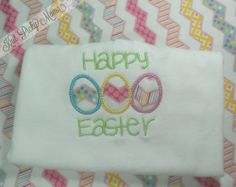 *This is a custom listing and not ready to ship*  Easter will be here before you know it! This shirt is perfect for your little one to rock for the whole Easter and spring season! It features 3 eggs that can be any color and the phrase Happy Easter.  Please see below for pre-order details.  -...