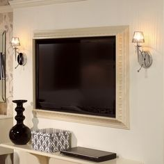 molding frame for flat screen TV........need to show my husband this - love this for the bedroom