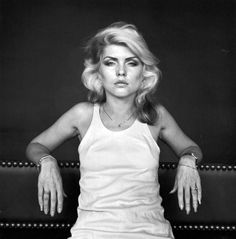 Debbie Harry 1978, by Robert Mapplethorpe. Seated, wearing white: punker than you.