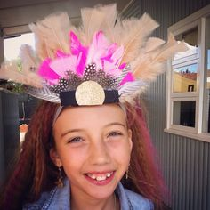 Feather head band. Fancy dress or Easter hat. Easter hat parade. Feathers. Dress ups. Easter hat. Easter bonnet. Simple Easter hat idea. Easy Easter hats. Cheap ideas for Easter hats Fancy dress party.