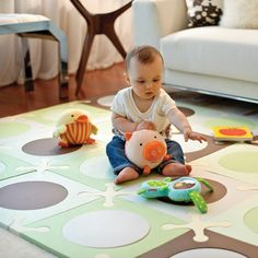 Create a safe, comfortable and versatile play area for your child with Skip Hop's innovative Playspot soft floor surface. Customize the size and design of your mat to fit your nursery or living room with its 20 stylish foam tiles featuring interchangeable inner circles. Its modern green and brown color palette is gender neutral and adds a subtle hint of color to a room. This cushioned Playspot is the perfect place for babies and infants to crawl, sit and play with toys that may scratch hard…