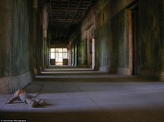 Plaything: Photographer John Gray has bravely ventured to more than a dozen of these forgotten institutions, photographing the deserted hallways, decaying rooms and remnants left behind behind by patients. Northampton State Hospital, MA, is pictured