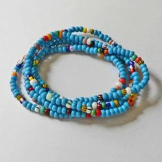 Hey, I found this really awesome Etsy listing at http://www.etsy.com/listing/75563319/turquoise-seed-bead-bracelet-set-of-5