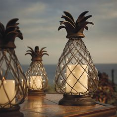 Pineapple Hurricane Lantern - Frontgate  These would look so awesome