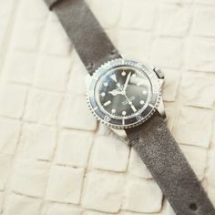 """This exquisite Rolex 5513 looks all the business paired up with our Bas and Lokes """"Argus"""" grey handmade suede watch strap. Available at www.basandlokes.com"""