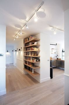 I love the wall lights  and interesting use os shelves - rather like a temp wall which I might use  Scandinavian Apartment by Soma Architekci