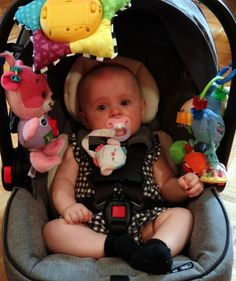 Baby in a car carrier with toys -missing one mommy and daddy - Peachy Diary