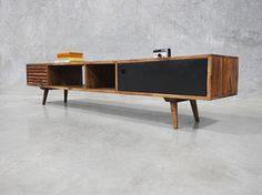 A mid century classic entertainment unit, combining simplicity, functionalism and quality craftsmanship. Australia Wide Delivery.
