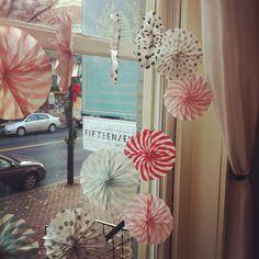window full of paper wheels
