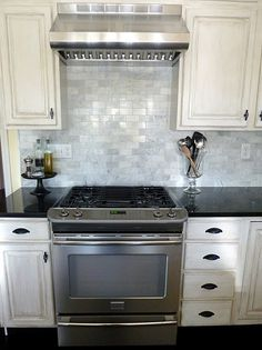 """Lowe's- Venatino polished marble   It's a 2""""x4"""" marble tile that comes in a 12""""x12"""" mosaic for $9.98. Slide in range awesomeness too!"""