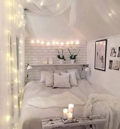A nice bed area that is colour coordinated. It also has some lights along the curtains and wall.