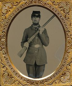 A beautiful sixth plate ruby ambrotype of this Union infantryman. Dressed in a four button sack coat with a US waist belt and sporting a dark blue kepi. He holds his musket diagonally across his chest. Nice crystal clear image of this soldier. Housed in a half leatherette case.
