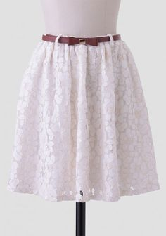 A lacey skirt topped with a darling bow belt.