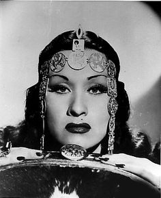 Yma Sumac - noted Peruvian soprano singer whose impressive vocal range spanned well over four octaves.