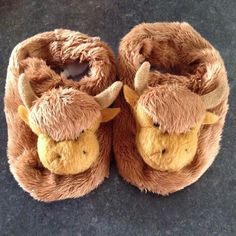 My sister brought these back from Scotland for baby girl! They are so cute!  . #cute #child #fluffy #gift #love #animal #fur #brown #baby #happy #family #smile #fun #beautiful #sweet #adorable #fashion #style #pretty #tribalchat #scotland #highlandcow #booties #blogger #comfy #babygirl