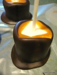 Marshmallows dipped in caramel, left to harden, and dunked in chocolate (all on a stick)