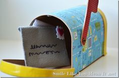 "Little Play Mailbox: base from Hobby Lobby, modge podged scrapbook, velcro ""stamps"""