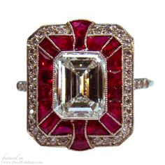 Art Deco rubi e anel de diamante em platina by Divonsir Borges - an Art Deco ruby ring featuring an emerald cut diamond and caliber cut halo of cabochon rubies and cross design - big vintage engagement rings - estate jewelry inspiration Art Deco Ring, Art Deco Jewelry, Fine Jewelry, Jewelry Design, Ruby Jewelry, Cheap Jewelry, Jewelry Rings, Jewellery Earrings, Jewelry Shop