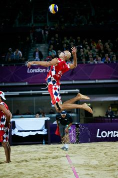 """London 2012 - At 209cm in height (6'9""""), Phil Dalhausser of the USA coils to release an explosive jump serve."""