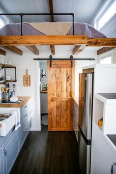 The storage stairs are large enough to accommodate a 9 cubic foot refrigerator. A 64-square-foot queen bedroom loft rests over the bathroom and part of the kitchen.
