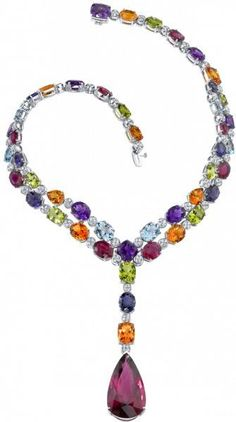 The Kaleidoscope Necklace contains a rainbow of natural gems, featuring a pear shape rubellite on a diamond necklace that is interspersed with amethysts, citrines, peridots, lolites and topaz in white gold by Robert Procop: