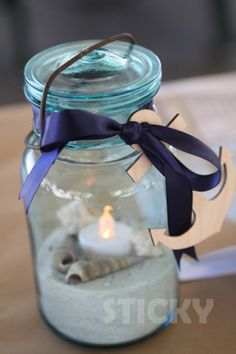 Vintage blue jars with ribbons and anchors.