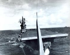 USS Lexington (CV 16) is photographed from the back seat of SBD dive bomber which has just taken off during TF-58 strikes in the Mariana Islands, 13 June 1944.  On 11 June, TF 58 aircraft damaged auxiliary submarine chaser No.8 Shonan Maru and aircraft transport Keiyo Maru, which was later sank by TF 58 aircraft on 13 June.