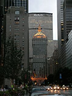 Helmsley Building in forefront, MetLife building behind.  The Helmsley Building is a 35-story building located at 230 Park Avenue between East 45th and East 46th Streets in Midtown Manhattan, New York City, which was built in 1929.  Behind the Helmsley is the MetLife Building.
