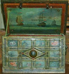 Holland  An 18th Century Polychromed Dutch Armada Iron Trunk, retaining original hardware and embellished with well patinated original painted panels of rural Dutch life, sailing vessels, paysage and other floral and foliate motifs, and with the interior lid painted with a scene of the Dutch armada galleons at sea
