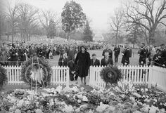 Jacqueline Kennedy in front of her husbands grave.