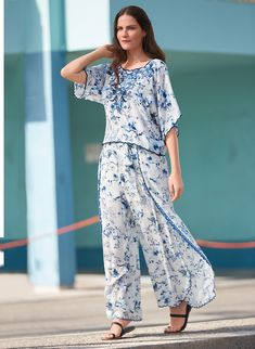 The fluttery sleeves and flowy effortless fit of our gorgeous Addy Top make it a must-have for spring. This chic blue and white blouse pairs beautifully with everything from simple denim to the matching printed pant. Blue And White Blouses, Resort Style, Printed Pants, Textile Prints, Jumpsuit, Feminine, Elegant, Chic, Outfits