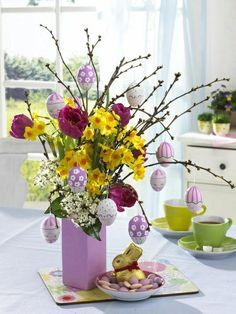 We always made an Easter Egg tree growing up... But never added flowers with it, so much more exciting!