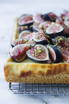 Ultra creamy cheesecake bars with a hint of honey, topped with fresh figs, pistachios, and an extra drizzle of honey! | Fork in the Kitchen #forkinthekitchen #figs #baking #dessert