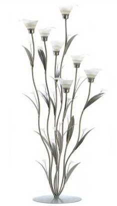 Silver Calla Lily candle holder featuring slender silver spires and leaves surrounding delicate frosted lily blooms; lovely by day, and enchanting when crowned with candlelight. An art-house treasure in the classic Art Deco tradition! Candle Stand, Tealight Candle Holders, Candleholders, Calla Lillies, Calla Lily, Tea Light Candles, Tea Lights, Candle Lanterns, Glass Candle