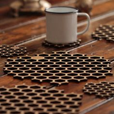The pattern in both the coasters and placemats creates unity. The few coloured-in shapes create contrast along with the regular shapes of the objects interest me.