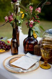 rustic red amd yellow flower and natural grass centerpieces in eclectic brown bottles love the bottle idea Brown Bottles, Old Bottles, Glass Bottles, Beer Bottles, Bottle Vase, Vintage Bottles, Grass Centerpiece, Table Centerpieces, Centrepieces