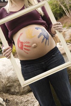 Love the idea of Mom, Dad, and sibling hands painted on the belly. #maternity