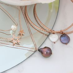 Layered necklaces and bangles. Jewellery to stack, mix and match #layerednecklaces #layeredbracelets #rosegold #boho #dainty #long #choker #pearl #gifts #star #christmas #bangles