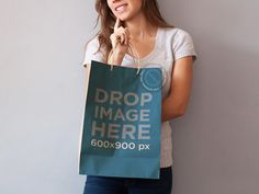 New! Paper Bag Mockup of a Woman Holding a Shopping Bag. Try it here: https://placeit.net/c/print/stages/paper-bag-mockup-of-a-woman-holding-a-shopping-bag-a6974
