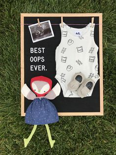 Pregnancy announcement using a letter board.