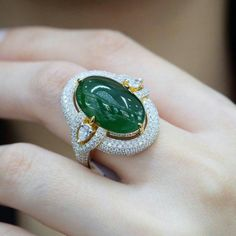 Myanmar jade 10.65ct surrounded by white diamonds.