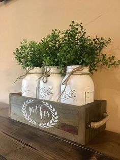 Add a custom touch to your home with this rustic mason jar centerpiece! All jars can be changed to fit your decor along with the flowers upon special request. Package includes: (1) 3 jar planter box (1) HAND PAINTED stencil (3) mason jars (3) flowers Measurements 12.75X5.5X3.5 without handles (with handles add about 1-2) Please message me with any special requests, I LOVE do custom orders, stencil can be changed to ANYTHING youd like