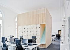 Parisian architect Estelle Vincent added wooden structures to the Champs Elysees HQ of marketing + data consultants Ekimetrics.