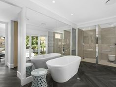 Photo of a modern bathroom design with freestanding bath using frameless glass from the bathroom galleries - Bathroom photo 17187061. Browse hundreds of images of modern bathrooms & photos of freestanding bath in bathroom designs.
